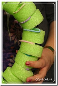 Make a model of the backbone skeletal system with pool noodle slices, hair ties, and clothesline.