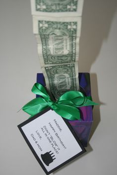 Tape dollar bills together and stuff in an empty Kleenex box with a tag that says-Don't Blow It All - LOVEZILLA