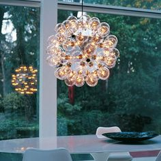 FLOS Taraxacum 88 modern pendant lamp was designed by Achille Castiglioni to encapsulate the shape of a dandelion.Enjoy 15% off FLOS decorative products, including iconic styles and contemporary best-sellers, through March 16th with code SPRINGSALE17.
