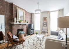 """A Light, Airy and Calming One Bedroom - """"I LOVE the leather <a href=""""http://www.roomandboard.com/catalog/living/recliners-and-lounge-chairs/callan-chair-and-ottoman-in-lagoon-leather"""" target=""""_blank"""">Callan armchair from Room and Board</a>. It brings so much depth into the living room and works beautifully with the oatmeal sofa, the marble nesting tables, the brick and the cream and black Moroccan rug. It is a true hero piece of that space."""" - @Homepolish New York City"""