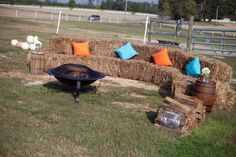 straw bale seating for around the dance floor. ditch the silly pillows and the firepit, cover bales with old quilts.