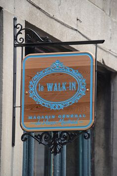 Wood sign carved cedar old Montreal. - le Walk In