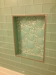[Love this idea of doing something different in the niche!] Vogue Bay (aqua beach sea glass) subway glass tile, iceberg (bubble) tile in shampoo niche, brushed nickel Schluter edge, white grout. Glass Subway Tile Backsplash, Glass Tile Bathroom, Glass Shower, Bathroom Niche, Shower Niche, Shower Tub, Tile Showers, Bathroom Showers, Bath Tub