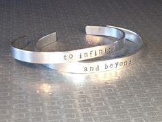 To Infinity and Beyond - Aluminum Cuff Bracelet - Toy Story Inspired Hand Stamped - Customizable - Set of Two par FamilyHouseStampin sur Etsy https://www.etsy.com/fr/listing/127682299/to-infinity-and-beyond-aluminum-cuff