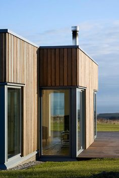Traditional materials + softly elegant modern design: vertical wood, soft contrast with window frame colour, simple windows, simple trim. Wood Cladding Exterior, House Cladding, Corner House, House On A Hill, Window Frame Colours, Cottage Extension, Farm Cottage, Architect House, House Extensions