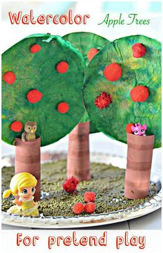Make apple trees with liquid watercolors and use them as props for pretend play