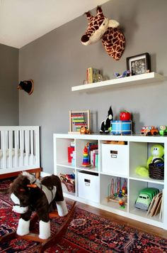 This is exactly what I want to do on one wall in the playroom. I have the rug, getting the toy storage next week. I LOVE the idea of a stuffed animal head... must get that too now.