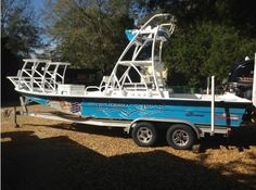2010 Shallow Sport Boats 24 Sport: keep the fish and drinks cool all day in the YETI Coolers Tundra 125 qt that's a bow seat with vinyl cushion.