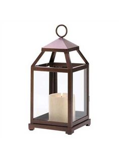 Bronze Carriage Lantern – Small  Bronze glazed metal carriage lantern, fits up to a 3 inch wide pillar candle. Perfect for tabletop decor.