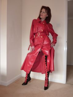 Red is the colour of passion, check out this beautiful babe in her kinky RED Rubber Rainwear!