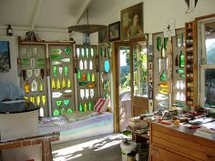 Art studio in New Zealand. I love the light coming in through the recycled glass bottles in the wall.
