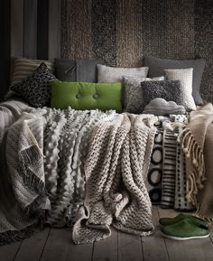 big grey couch, comfy blankets, lots of pillows