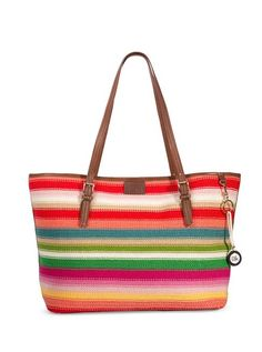 Our large knit tote is roomy enough to fit all your necessities and features our signature stripes.