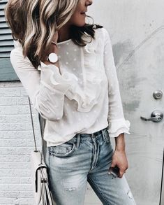 Pretty white blouse with denim jeans.