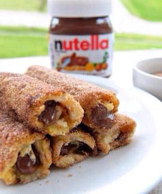 Nutella French Toast Rolls with Cinnamon Sugar  10 slices of white bread, 10 teasp of nutella 1 egg 1 and 1/2 tbsp milk  1/2 cup sugar 1 tbsp ground cinnamon butter, for frying Remove crusts Roll slice of bread with rolling pin. Spread each slice of bread with teasp of nutella. Roll bread tightly, seal shut with nutella. Whisk egg and milk combined.  Combine sugar and cinnamon Heat butter in skillet.  Dip roll in egg mixture til coated, place on hot skillet.  Lightly fry  roll in cinnamon sugar