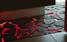 Stone set on a glass sheet that is lit red by LED lighting--The floor is lava!