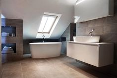 This sleek and spacious bathroom features the ios freestanding tub and an ios 80 vessel basin. Simple and chic.