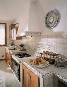 A beautiful kitchen with amazing tiles that are both creative and rustic by Acquario Due Shabby Chic Kitchen, Vintage Kitchen, Kitchen Decor, Farmhouse Kitchen Cabinets, Kitchen Countertops, Cupboard Makeover, Classic Cabinets, Italy House, Solid Wood Dining Set