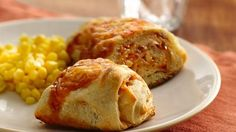Chicken Enchilada Crescent Bake    INGREDIENTS  2cups shredded cooked chicken  1can (10 oz) red enchilada sauce  2cans (8 oz each) Pillsbury® refrigerated crescent dinner rolls or 2 cans (8 oz each) Pillsbury® Crescent Recipe Creations® refrigerated seamless dough sheet  1 1/4cups shredded Mexican cheese blend (5 oz)