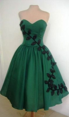 Vintage cocktail dress with pretty leaf. Love it! 50's Poison Ivy.