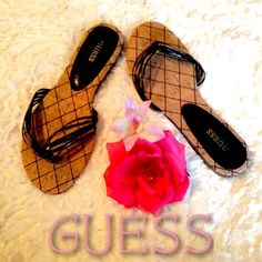 Guess Flip Flops Sandals Guess Flip Flops Sandals, size 9. Worn only a few times, in very good condition. Soft cork bottoms with black plastic straps. Very comfortable, flat summer shoes! Guess Shoes Sandals