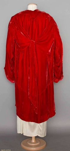 """LUCILE PARAY EVENING COAT, PARIS, c. 1930 (back view) Coral silk velvet, bell shaped sleeve, asymmetrical hemline, lined in coral silk & white floral printed chiffon, CB tie panels, labeled, L 38""""-46"""""""