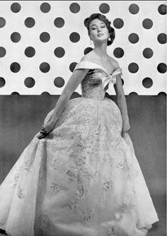 1954 Model in gorgeous ball gown of embroidered tulle, off-the-shoulder bodice edged in satin, by Jacques Fath,