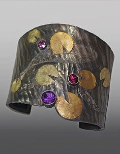 """Wolfgang Vaatz: Cuff in 14k yellow and green gold, carved & engraved argentium silver, 8mm amethyst, 6mm color changing pink garnet, and 5mm pink tourmaline. 1.88"""" h x 2.5"""" w x 2.27"""" w."""