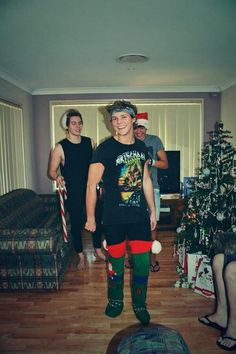 Merry Christmas, look at Calums face in the background XD
