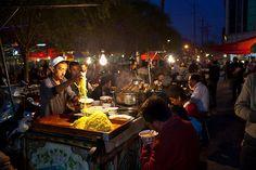 Food vendors in outdoor market, Kashgar, XinJiang, China.