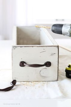 Learn how to get a rustic, chippy paint finish the fast and easy way! Get all the details plus a tutorial for this DIY wood box at LoveGrowsWild.com