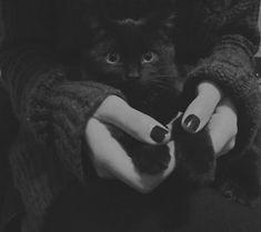 girl holding black cat