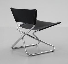 An Erik Magnussen chromed steel and black leather 'Zdown' chair, Engelbrechts, Denmark.