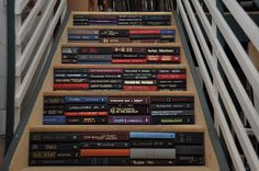 Bookish staircase by Juniper Books. This is purely for show with decorative spines, but think of the storage possiiblities!