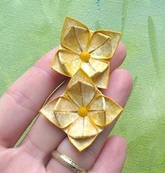 Boucles doreille Origami lotus de métal inox