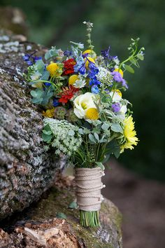 white, yellow, blue and red bouquet on rocks - wedding photo by top Philadelphia based wedding photographers Langdon Photography