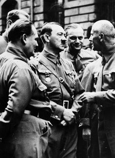 The Fuehrer rocking the world on November 9, 1938 in Munich. Goering, Rosenberg and Frick vainly try to garner attention. All in vain. (via putschgirl)