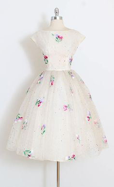➳ vintage 1950s dress * rare and stunning hand painted dress * white chiffon over tulle and acetate * vivid floral and paint splatter dots * metal back zipper condition | excellent - few pinhead sized holes and tiny spots on lining - neither takes away from the beautiful presentation of this dress fits like xs/s length 43 bodice 16 bust 36-38 waist 26-27 ➳ shop http://www.etsy.com/shop/millstreetvintage?ref=si_shop ➳ shop policies http://www.etsy....