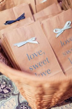 Paper bags, rubber stamp, acryclic paint, ribbon, and glue make adorable gift bags, favor bags, candy bags....