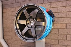 air hose reel or extension cords in the garage for Bryan Garage Tools, Garage Shop, Garage Workshop, Garage Storage, Man Cave Automotive, Automotive Decor, Garden Hose Storage, Tire Furniture, Mechanic Shop