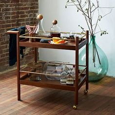 The Parker Mid-Century Bar Cart from #westelm is a great retro addition to a room, and would be great in a living room or library/office for a bar moment.