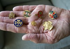 Girl Scouts at 100: Still 'courageous and strong' - The Orange County Register. A handful of vintage Girl Scout pins are displayed by Nancy Rose Teigen.  She swapped with other girls at the 1956 International Girl Scout Round-Up held at Highland State Park, Milford, Michigan.
