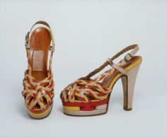 These are ridiculous and completely freakin' fab.  Insane braided sandals from WWII-era Britain.