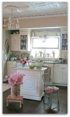 Adorable pink shabby chic tiny home kitchen ~ love this little kitchen with the tiny island. Even the chandelier is eensy!