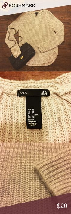 H&M cream Sweater So warm and cozy. XS but can fit a small. V neck. 90% Acrylic 10% Mohair. Used a few times no stains no rips, no pilling. H&M Sweaters