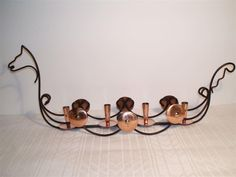 Advent candle holder /vikingship from YSTAD METAL - design GUNNAR ANDER in copper and iron - 47cm in length, 9cm at tallest point -- weight 382 grams AWESOME buy - paid about 13 dollars for this gorgeous vintage piece.  Adventsljusstake Vikingaskepp Ystad metall , Gunnar Ander