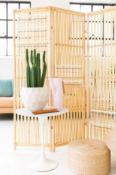 Small space? Don't fret. We're taking cues from Ashley Rose of Sugar & Cloth, who elevated the Jassa room divider with a colorfully woven detail.