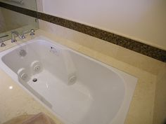 Master Bathroom - Sanijet pipeless whirlpool tub to replace old whirlpool. Is cleaner and quieter.