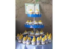 Rubber Ducky Baby Shower. Those look like baby food jars with the duck glued on top, filled with candy. Could recreate easily