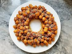 Honey balls, a classic Italian dessert that combines citrus-scented fried dough and a lemon-honey syrup, make a lovely centerpiece for a special occasion. Italian Cookies, Italian Desserts, Italian Recipes, Italian Foods, Struffoli Recipe, Great Grains, Delicious Desserts, Dessert Recipes, Italian Bakery